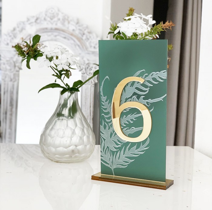 Emerald and gold engraved table number