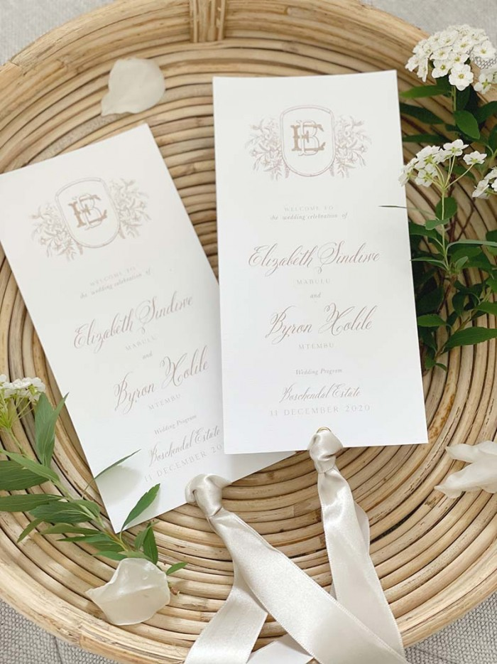 Elizabeth and Byron program cards with ribbon